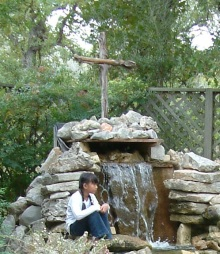 cross, waterfall, girl praying, orphan, adoption