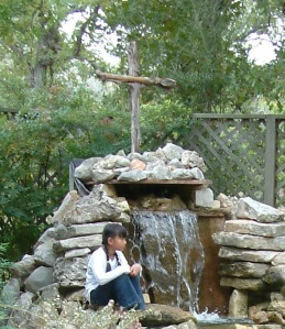 cross, waterfall, waterfall with cross, girl by waterfall, girl praying, adoption, hope, nature, water garden
