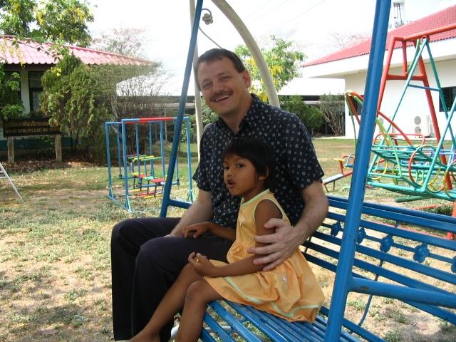 orphanage, Thailand, Bangkok, girl swinging, girl and daddy, adoption, adoptive dad