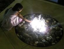rock fountain, girl in fountain, girl by fountain, fountain with light, lighted fountain, playing in fountain, water fountain, adoption