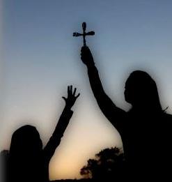 cross, cross in sky, woman holding cross, girl reaching up, Christ, hope, grace, glory