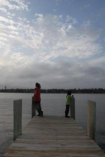 standing on dock, standing on pier, mother daughter by lake, woman girl lake, waiting by lake