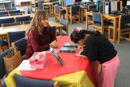 Ed White Elementary school, library, elementary school library, book signing, Nine year Pregnancy, girl writing note