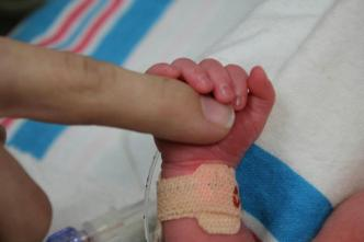 baby hands, baby fingers, baby holding finger, preemie, baby in hospital