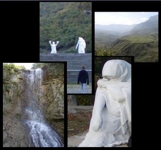 statue, praying woman, praying woman statue, waterfall, raised hands statue