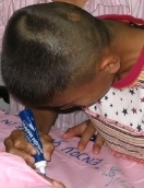 boy signing, pillowcase signing, Thai boy