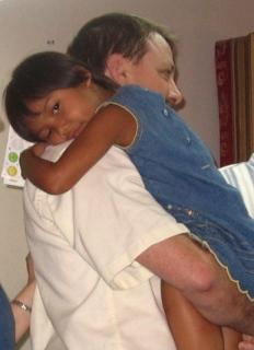 hugs, hugging, father daughter, adopted, adopting, hugging daddy, international adoption, transracial adoption, international adopted family,