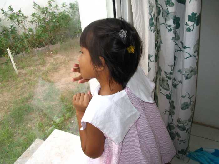 child waiting, child by window, girl kissing window, orphan