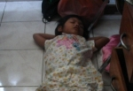 sleeping child, asleep on floor
